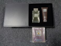 A Lalique gift set comprising of hair and body shower gel and a Lalique Pour Homme natural spray