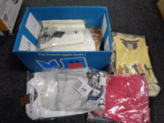 A box of new and un-used clothing including shirts,