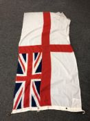 A British White ensign flag CONDITION REPORT: This measures 180cm by 93cm.