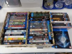 Two boxes of blu-ray discs, some sealed.