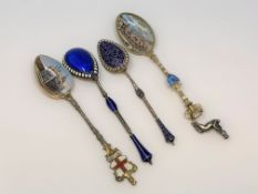 Four ornate silver and enamel spoons.