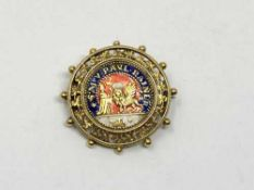 An antique 18ct gold and enamel brooch 'S M V PAUL RAINER', 7.4g, diameter 32 mm.