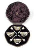A boxed set of four Victorian silver gilt salts and spoons,