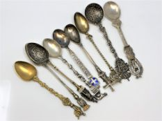 Nine highly ornate silver gilt and enamel spoons, including Napoleon.