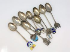 A collection of silver and enamel Scottish, Welsh spoons, Glasgow, Forfar, Dumfries, Edinburgh,