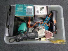 A crate of tools, disc sander,