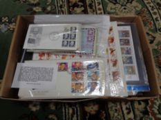 A box of first day covers and stamps,