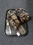 Four vintage woodworking planes including Record,