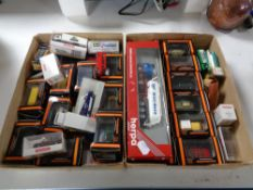 Two small trays of die cast model vehicles,