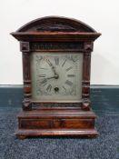 An Edwardian stained beech mantel clock