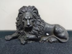 A Victorian cast iron door stop modelled as a recumbent lion CONDITION REPORT: Some
