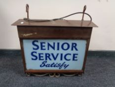 An early 20th century illuminated sign 'Senior Service Satisfy' CONDITION REPORT:
