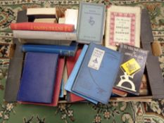 A box of various books,