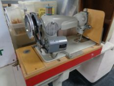 An mid century sewing machine by Acadex