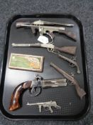 A collection of miniature rifles and pistols,