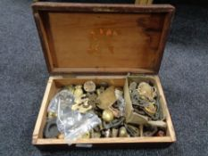 A pine box containing brass and other furniture parts, door escutcheons, handles,
