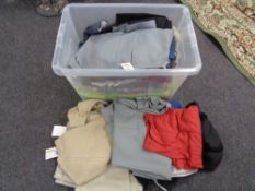 A crate of new and un-used clothing, trousers,