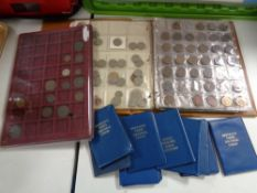 A folder of coins, UK and world coins,