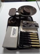 A tray of cutlery, cast iron weights,