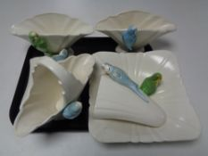 A tray of ceramic budgerigar,