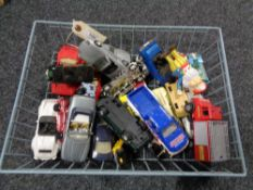 A wire basket containing mid century and later die cast vehicles, Corgi,