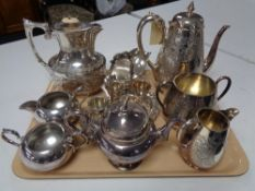 A three piece silver plated tea service, together with various other plated wares, teapot,