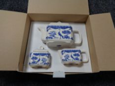 A Wade blue and white teapot, sugar basin and cream jug, in retail box.