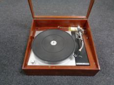 A Thorens TD-150 turntable together with a pair of Rogers teak cased speakers