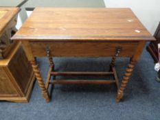 An Edwardian oak side table fitted with a drawer