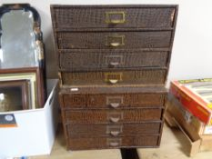 A set of two banks of four office storage drawers