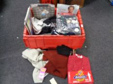 A crate of new and un-used clothing, scarf, gloves,