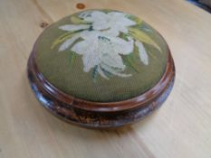 A Victorian tapestry circular stool