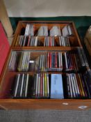 Two stands containing cds