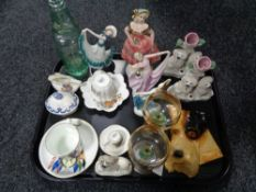 A tray of china ornaments, three Staffordshire figures, dog plaque, antique mineral water bottle,