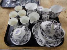 A tray of Elizabethan storm pattern tea china