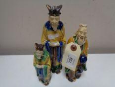 Three twentieth century glazed pottery figures of Chinese elders