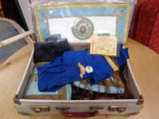 A vintage suitcase containing Masonic apron,