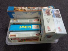 A crate containing model kits, mainly buildings,