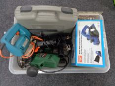A crate of tools, electric drill, jigsaw, router, electric planer,