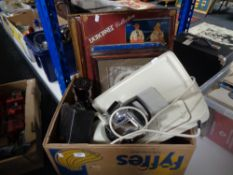 A box containing Teasmade, box camera, metal sign,