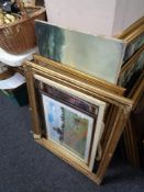 Two gilt picture frames, oil on canvas depicting boats,