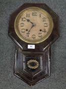 An early twentieth century Seikosha Japanese wall clock with pendulum