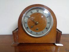 A 1920's oak mantel clock