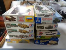 Eleven model kits to include Airfix, Tamiya etc,