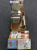 A box of a quantity of Airfix and other model making kits