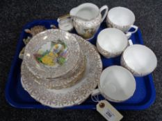 An English bone china tea set with 22ct gold gilding together with Wade Whimsies and animal figures.