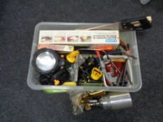 A crate containing tools, saw, clamps, paint spraying pod,