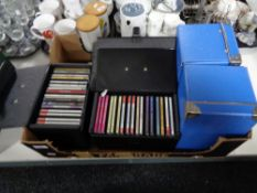 A box of cds, cases containing cds.