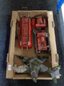 Two tin plate models of fire engines and another of a fighter jet.