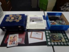 A quantity of collector's coins, plastic coin wallets,